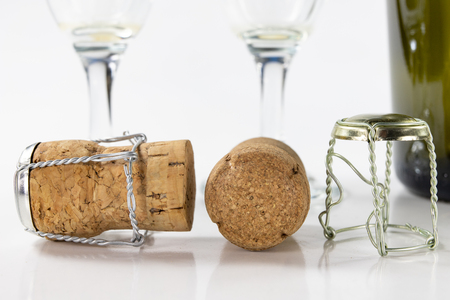 Cork from champagne on a kitchen table. Good New Years drinks and great fun. Light background.