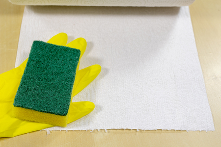 Sponge and liquid for cleaning the surface at home. Accessories for keeping household clean. Light background.