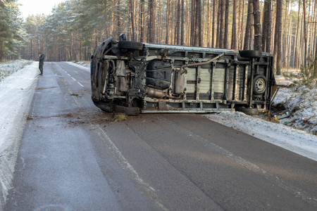 Podlesie, pomorskie  Poland - January, 30, 2019: A road accident of a delivery vehicle on an icy road in the forest. Season winter. Editorial