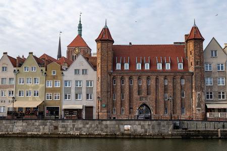 Gdansk, pomorskie  Poland - February, 07, 2019: Długie, seashore on the Motława River. Tenement houses and moored ships.Season winter.