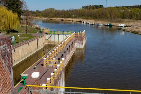 Biala Gora, pomorskie / Poland - April, 16, 2019:. The construction of the hydrological tower. Sluice regulating the water level in the Central Europe. Season of the spring.