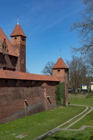 Malbork, pomorskie / Poland - April, 16, 2019 :: Historic Teutonic castle in Central Europe. A brick building from the Middle Ages. Season of the spring. Season of the spring.