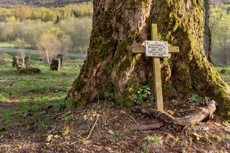 Wolosate, Malopolskie / Poland - April, 28, 2019: Old cemetery in a village in the mountains. Burial place in a small village. Season of the spring.