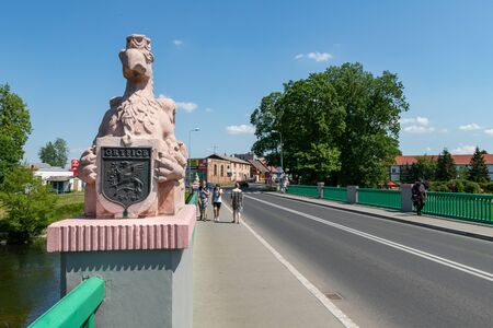 Gryfice, zachodniopomorskie / Poland - June, 5, 2019: Bridge over the river in a small town. The tower and old town walls on the river. Season of the spring. Publikacyjne