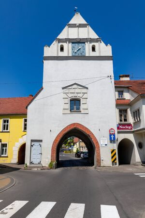 Gryfice, zachodniopomorskie / Poland - June, 5, 2019: Bridge over the river in a small town. The tower and old town walls on the river. Season of the spring.
