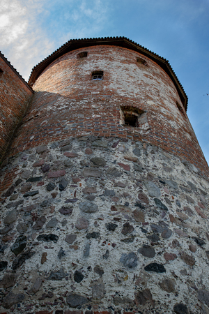 An old tower built of red brick.Tower in a small town in Central Europe. Season of the spring. Foto de archivo