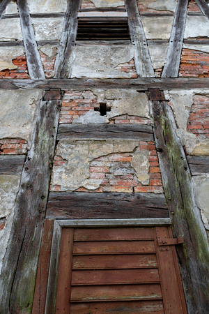 An old construction called the Prussian wall used in Pomerania in Europe. The historic wall construction in the Pomeranian countryside. Season of the spring. Stok Fotoğraf