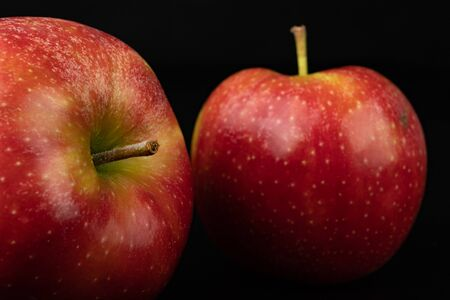 Tasty ripe apple on a dark table. Rich berries prepared to eat. Black background.