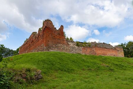 Stare Drawsko, zachodniopomorskie / Polska - July 9, 2019: Old ruins of the Joanit castle in Central Europe. Old medium stronghold between two lakes. Season of the summer.