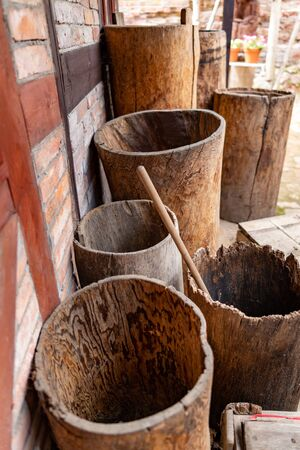 Water containers made of wood. Old barrels carved from the trunk of a tree. Place - open-air museum.