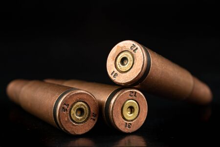 Ammunition of a high-speed rifle. Cartridges for a military rifle. Dark background.