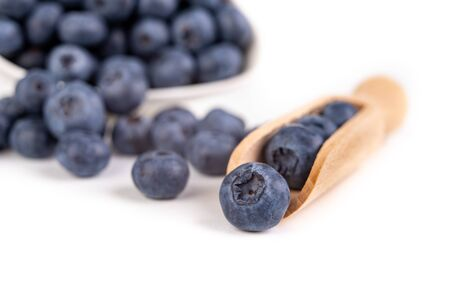 Tasty ripe blueberry fruit on the kitchen table. Ingredients for a delicious dessert in the home kitchen. Light background.