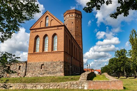 Czluchow, Pomeranian / Poland - August 8, 2019: Teutonic castle in Central Europe. Old stronghold built of red brick. Summer season.