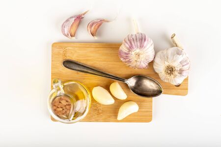 Home remedy for cold garlic. Squeezed vegetable juice in a bottle. Light background.