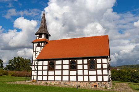 A small church built in the technology of the Prussian wall. Christian Temple in Central Europe. Autumn season. Imagens