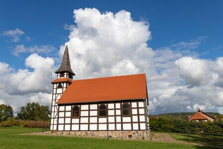 A small church built in the technology of the Prussian wall. Christian Temple in Central Europe. Autumn season. Stock Photo