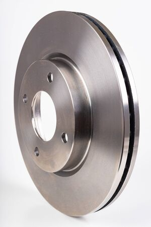 Steel brake discs for a passenger car. New spare parts for car repairs. White background.