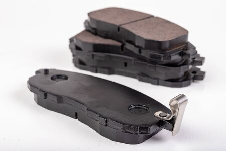 Brake pad for a passenger car. New spare parts for car repairs. White background.