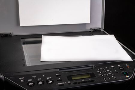 Printer with the option of copying on a dark table. Multifunction device intended for home use. Black background.
