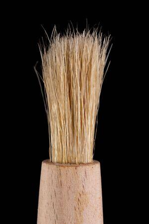 Kitchen bristle brush. Kitchen accessories for oil lubrication. Dark background. Stock fotó
