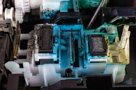 A place to dock ink cartridges. Dirty old home printer. Place - workshop.