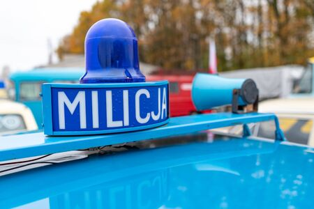 Sepolno krajnskie, kujawskopomorskie  Poland - November, 11, 2019: Blue signal lights mounted on an old police car. Inscription Milicja on an old restored patrol car. Autumn season.
