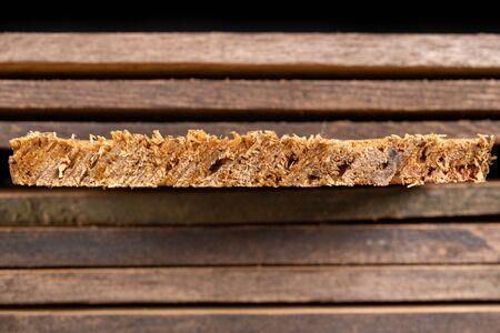 Raw wooden boards. Heavily jagged wood edges. Dark background. Stock fotó