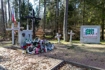 Hopowo, pomorskie / Poland - March, 17, 2020: Place of national memory in the Hopowski forest. Collective grave in Pomerania. Spring season.