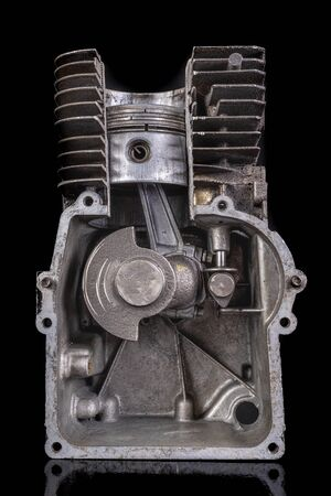 Four-stroke internal combustion engine in section shown. Petrol engine piston. Dark background.