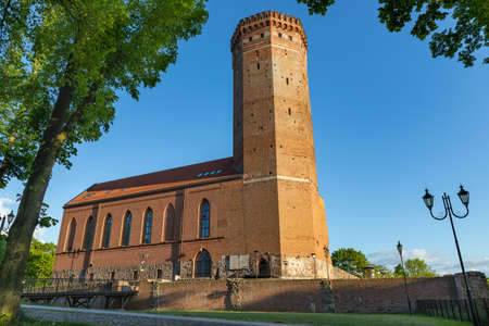 Czluchow, pomorskie / Poland - May, 26, 2020: Old tower of the Teutonic castle from the Middle Ages. Red brick building in Central Europe. Spring season.