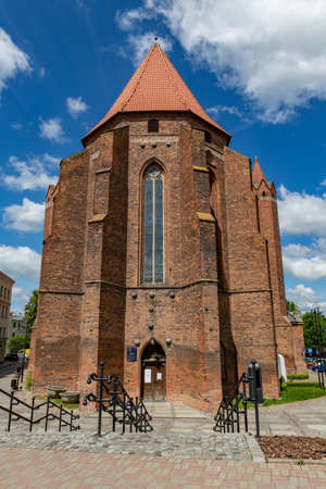 Kwidzyn, pomorskie / Poland - June, 2, 2020: Cathedral in a small city. Brick building in Central Europe. Spring season .