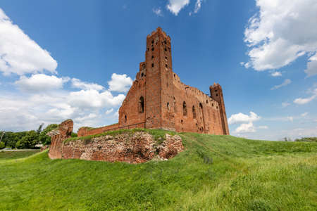 Radzyn Chelminski, kujawsko-pomorskie / Poland - June, 30, 2020: Teutonic castle in Central Europe. Old stronghold built of red brick. Summer season.