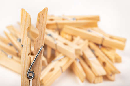 Wooden clothes pegs. Household accessories. White background.