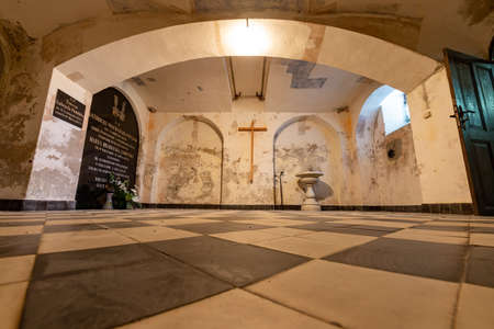 Potulice, kujawsko pomorskie / Poland - August, 05, 2020: Crypts in the vaults of a small chapel. The Potulicki tomb. Summer season.