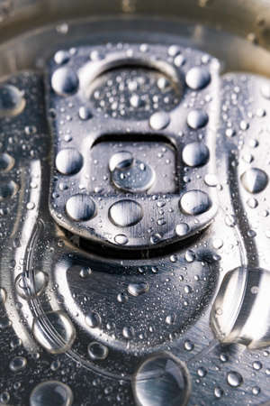 Wet pin on the can. A refreshing drink closed in a metal container. Big close-up.