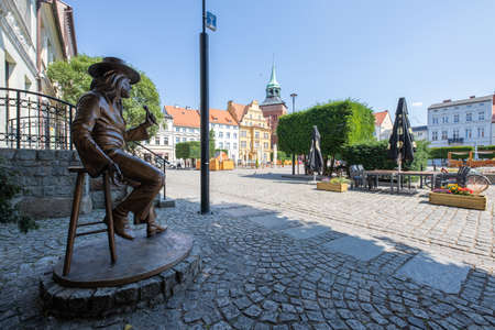 Karlino, Zachodniopomorskie / Poland - August, 7, 2020: Czeslaw Niemen monument in the market square in Bialogard. Statue of a famous musician on the market square in Poland. Summer season. Editorial