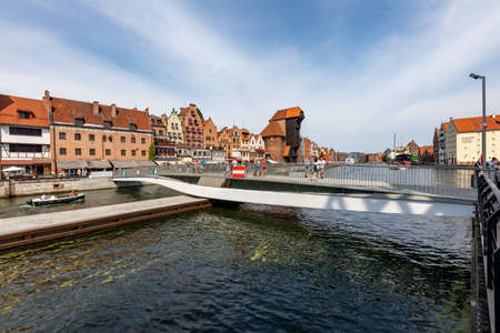 Gdansk, pomorskie / Poland - August, 8, 2020: New footbridge. A crossing for tourists in the Old Town in Gdansk. Summer season. Editorial