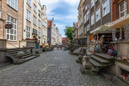 Gdansk, pomorskie / Poland - August, 8, 2020: Mariacka Street with beautifully decorated buildings. Historic tenement houses in the city of Central Europe. Summer season.