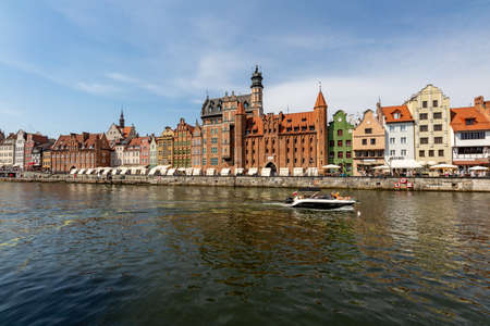 Gdansk, pomorskie / Poland - August, 8, 2020: View of the Long Seashore in Gdansk. Dead Vistula canal and historic tenement houses. Summer season.