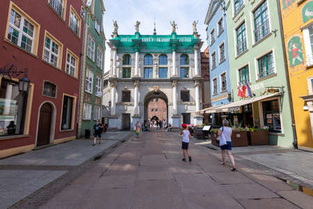 Gdansk, pomorskie / Poland - August, 8, 2020: Golden Gate in the Old Town of Gdansk. Historic tenement houses in the city of Central Europe. Summer season. Editorial