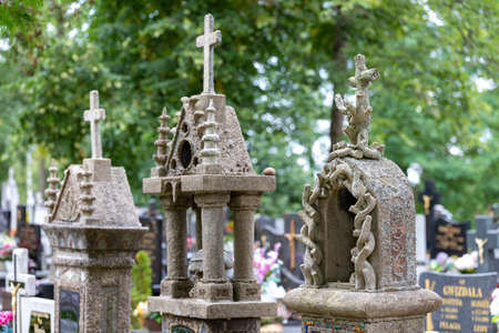 Sliwice, kujawsko pomorskie / Poland - September, 11, 2020: Old tombstones in a cemetery in a small village. The graves of the last century in Central Europe. Autumn season. Editorial