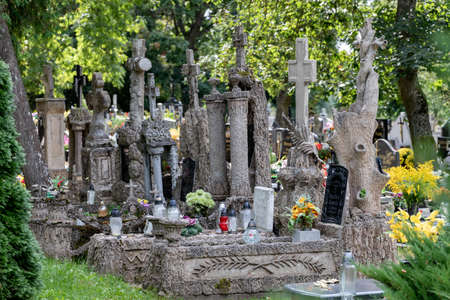 Sliwice, kujawsko pomorskie / Poland - September, 11, 2020: Old tombstones in a cemetery in a small village. The graves of the last century in Central Europe. Autumn season.