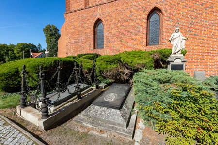 Pelplin, Pomorskie / Poland - September, 18, 2020: Old tombstones in a cemetery in a small village. The graves of the last century in Central Europe. Autumn season.