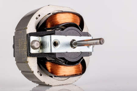 Small electric motor. Drive for small household appliances. Light background.