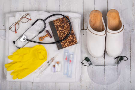 Basic medical kit prepared for vaccinations. Protective clothing and medical accessories. Light background.
