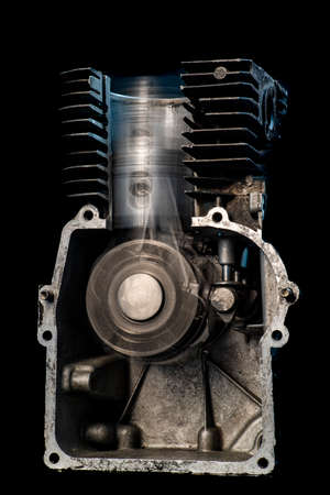 Internal combustion engine in motion. View of the piston and crankshaft in an internal combustion engine. Dark background.