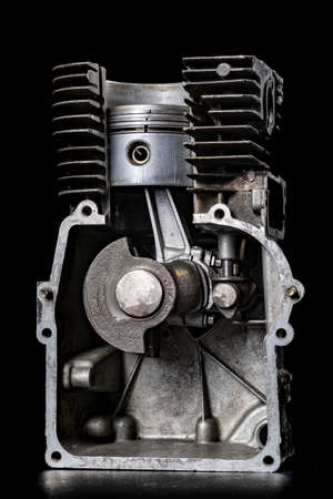 Internal combustion engine in cross section. View of the piston and crankshaft in an internal combustion engine. Dark background.