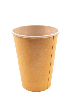 Paper cup for hot drinks. Disposable container for food use. Light background.