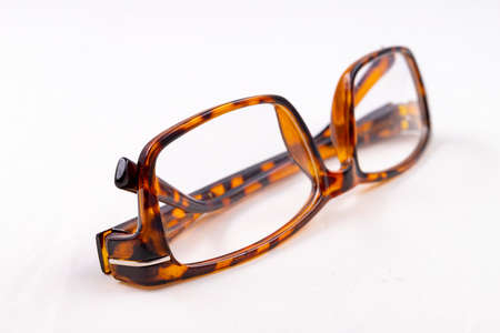 Glasses for people with visual impairments. Magnifying glasses for reading. Light background.
