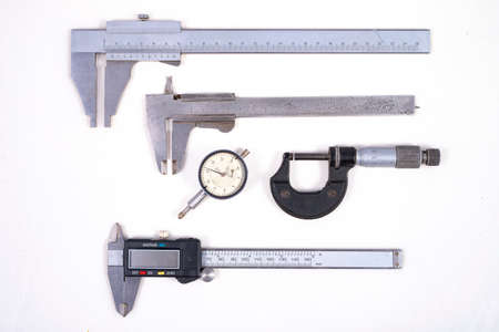 Measuring tools used for workshop measurements. Metal accessories for checking the gaps in the locksmith's workshop. Light background. 스톡 콘텐츠